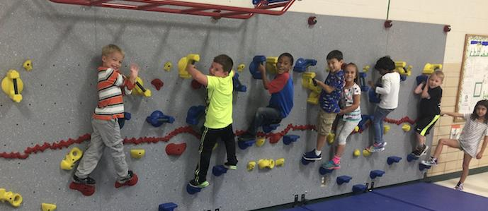 Neff Kindergarten Students Enjoy their new Rock Wall thanks to the PTA